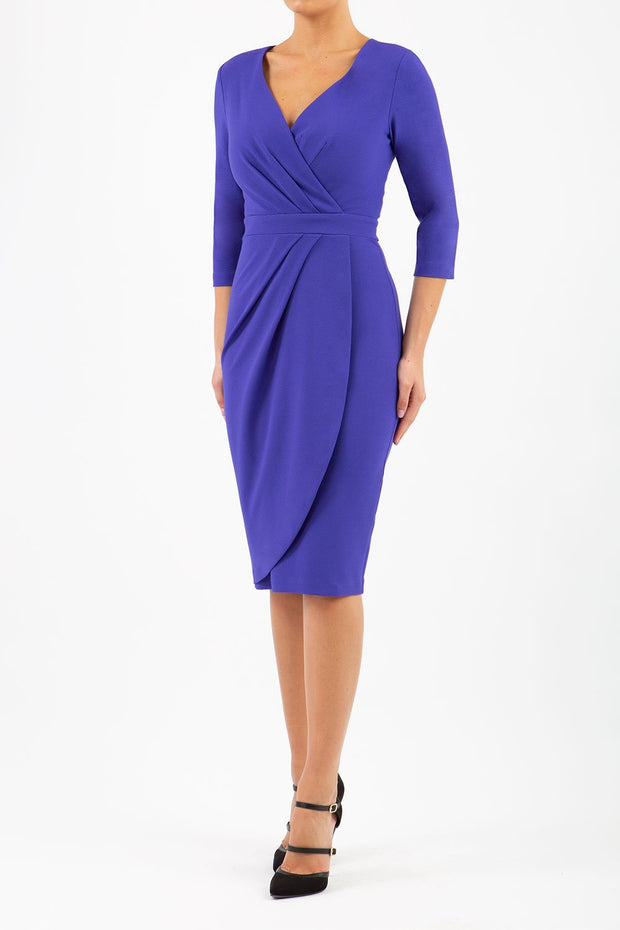 model wearing diva pencil dress tulip design with overlapping pencil skirt with 3 4 sleeves in colour spectrum indigo front
