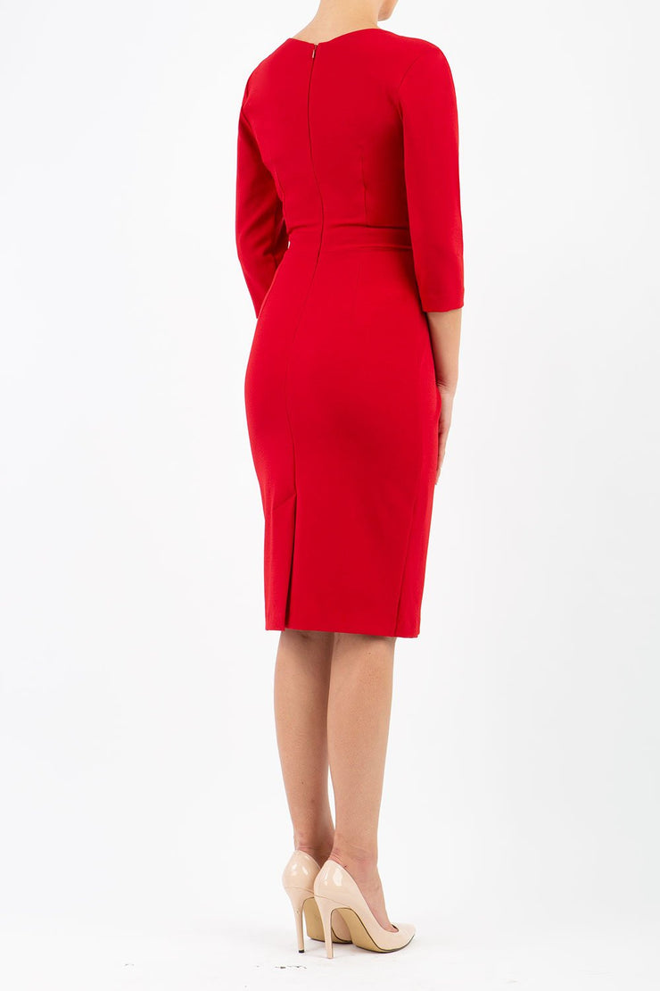 model wearing diva catwalk elan elegant red dress with 3 4 sleeves with a tie detail and asymmetrical closing back