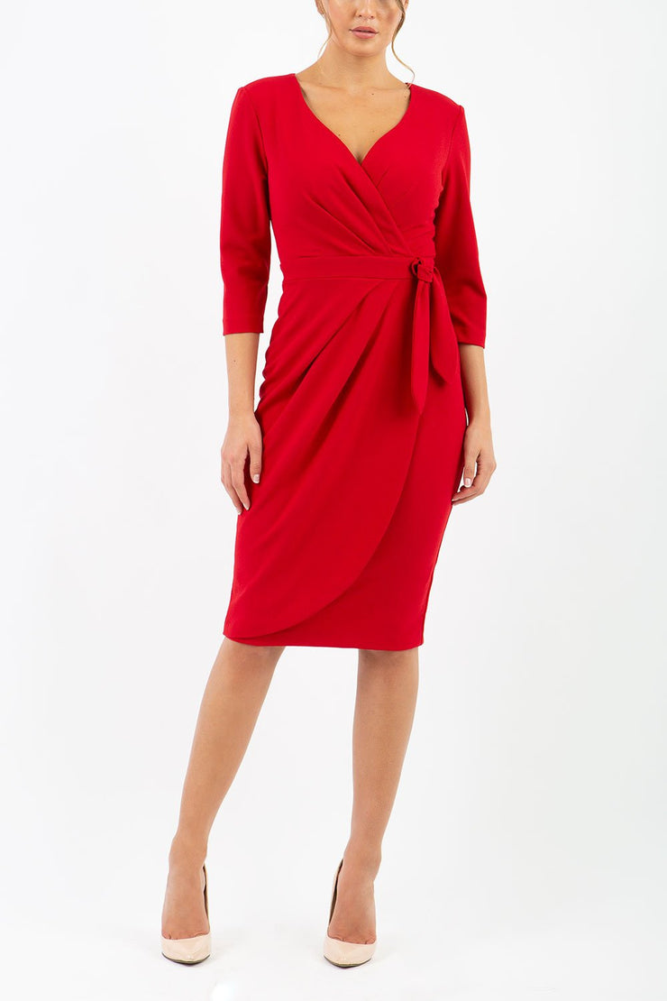 model wearing diva catwalk elan elegant red dress with 3 4 sleeves with a tie detail and asymmetrical closing front