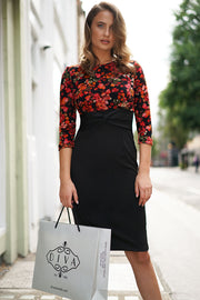 Model wearing the Diva Chiltern Print dress with round neckline in autumnal print front image