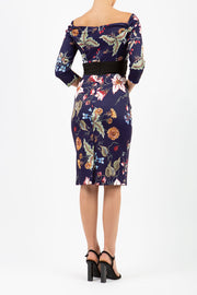 model wears Alpa Print off the shoulder pencil sheath Dress with long sleeves wild flower print back image