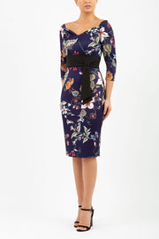 model wears Alpa Print off the shoulder pencil Dress with long sleeves wild flower print front image