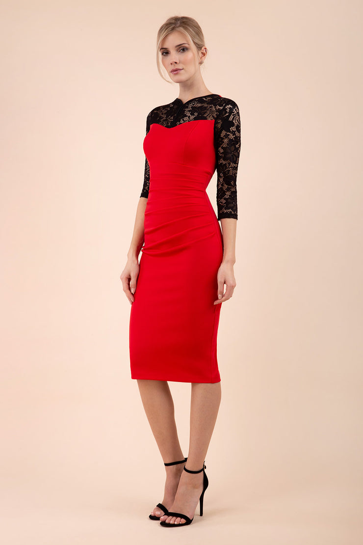 blonde model wearing diva catwalk haversham three quarter contrast pencil dress with lace detail across arms and neckline with pleating cross body in red and black front