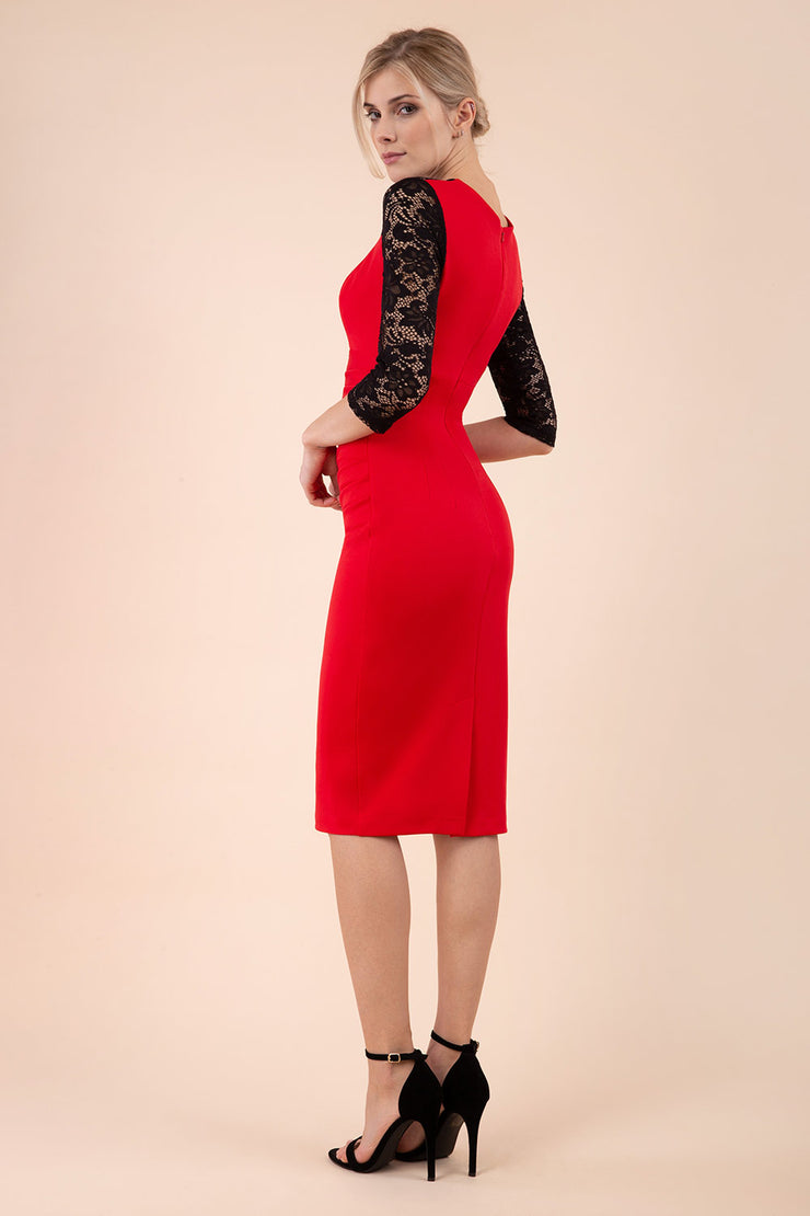 blonde model wearing diva catwalk haversham three quarter contrast pencil dress with lace detail across arms and neckline with pleating cross body in red and black back