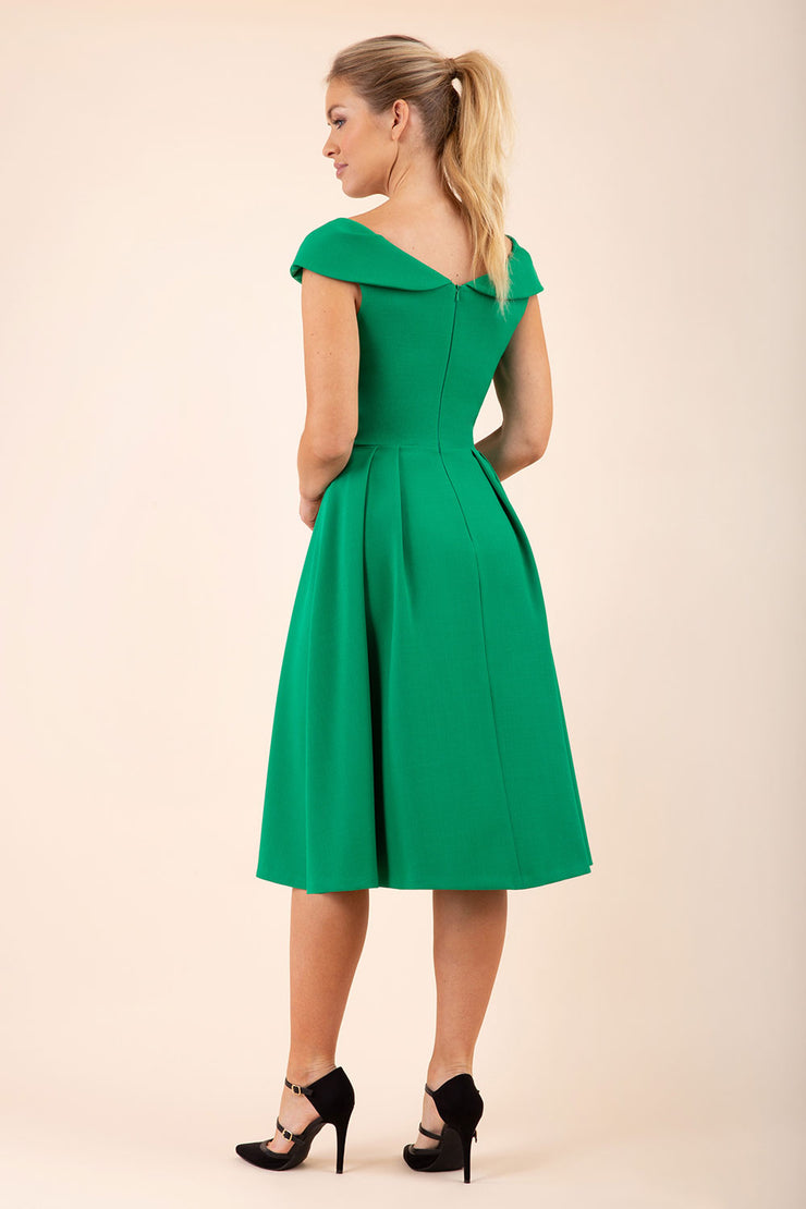 blonde model wearing diva catwalk Chesterton Swing Sleeveless dress in emerald green back