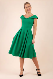 blonde model wearing diva catwalk Chesterton a-line skirt Swing Sleeveless dress in emerald green front
