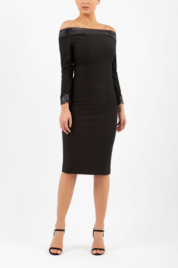 model wearing diva catwalk toto pencil-skirt dress off shoulder bardot neckline with sparkles at the top and long sleeves in black like Christmas party dress front