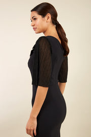 brunette model is wearing diva catwalk black pencil black dress with  bow back image