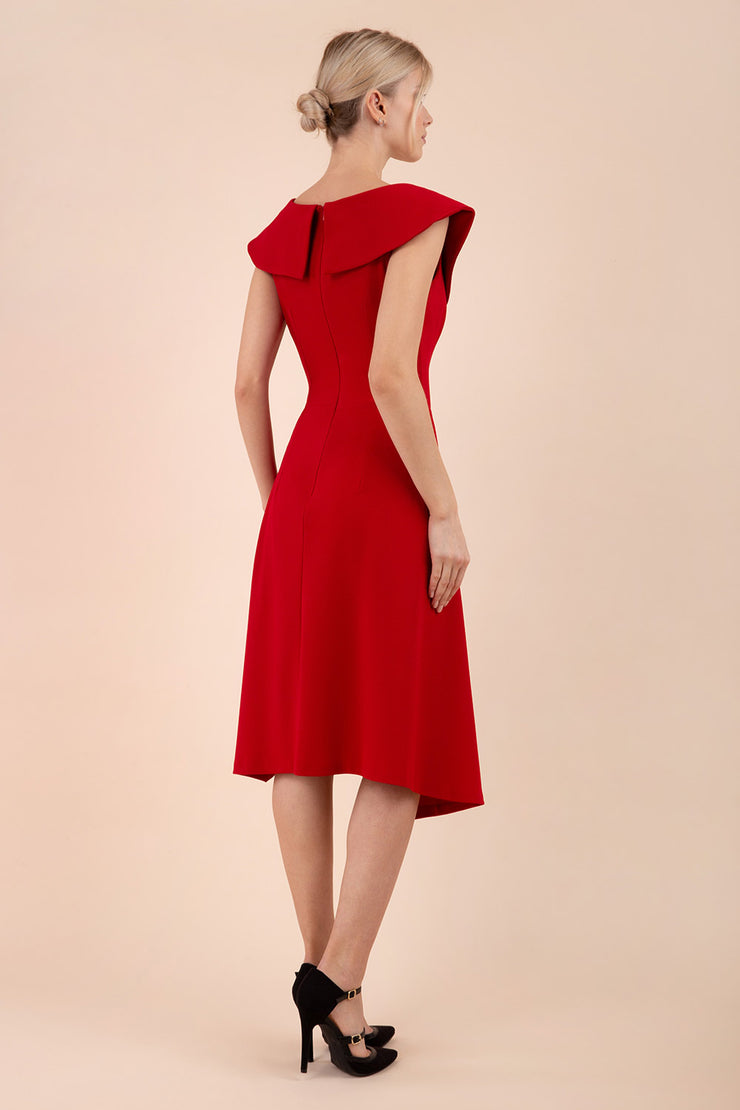 Model wearing the Diva Abaline dress in swing dress design in scarlet red front image