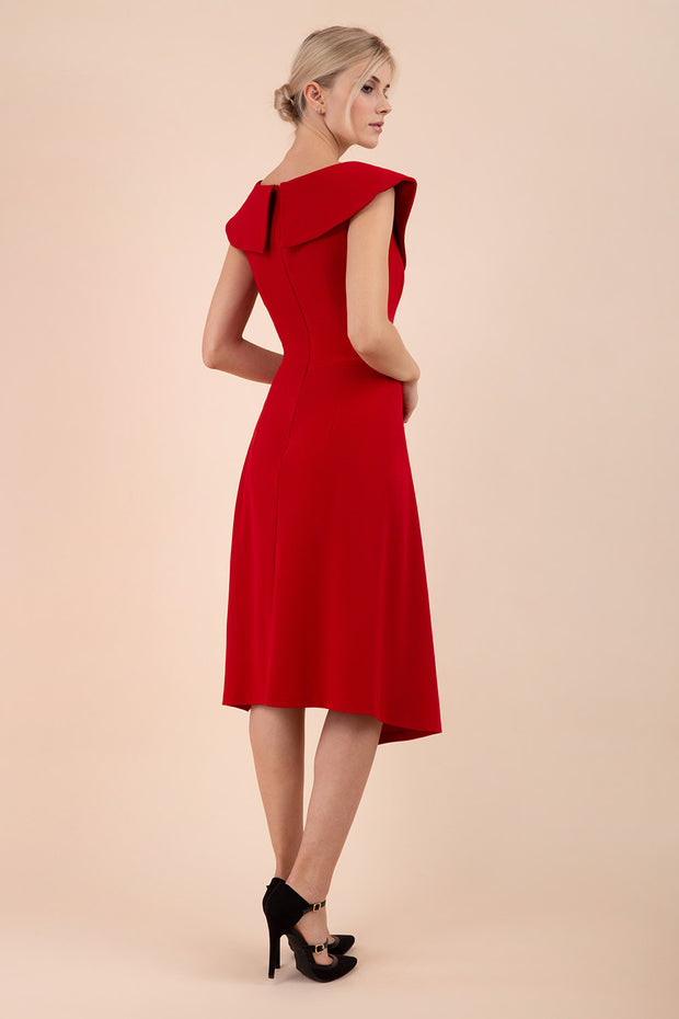 Model wearing the Diva Abaline dress in swing dress design in scarlet red back image