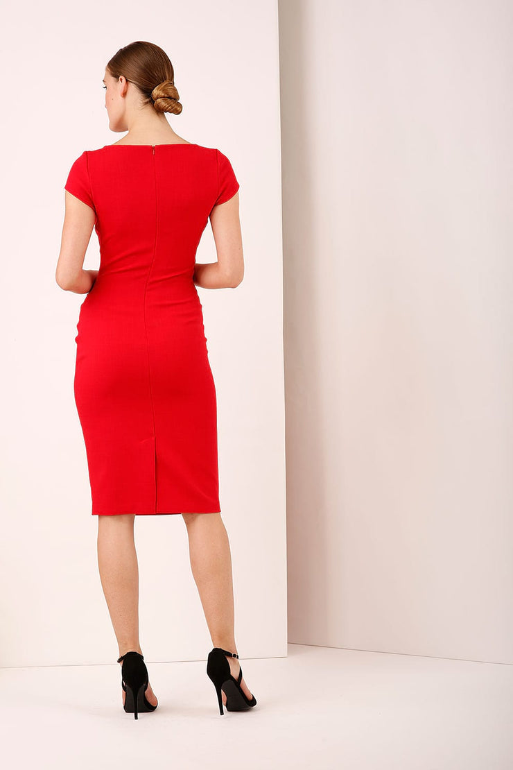 A model wearing a bow detail round neckline pencil knee length dress with pleating detail at the front in red by Diva Catwalk back