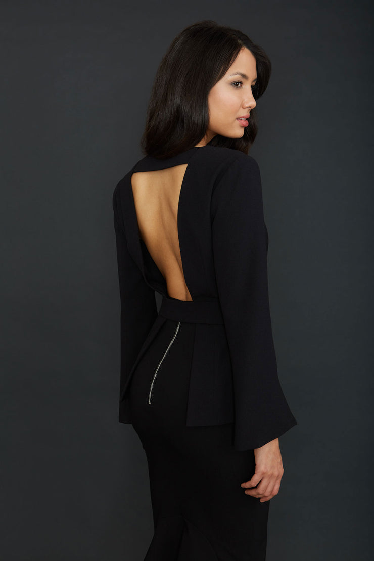 Brunette Model wearing Diva Catwalk Attimo Full length sleeve cut out back Jacket with belted waistline and sleeves with slits from elbow in Black back