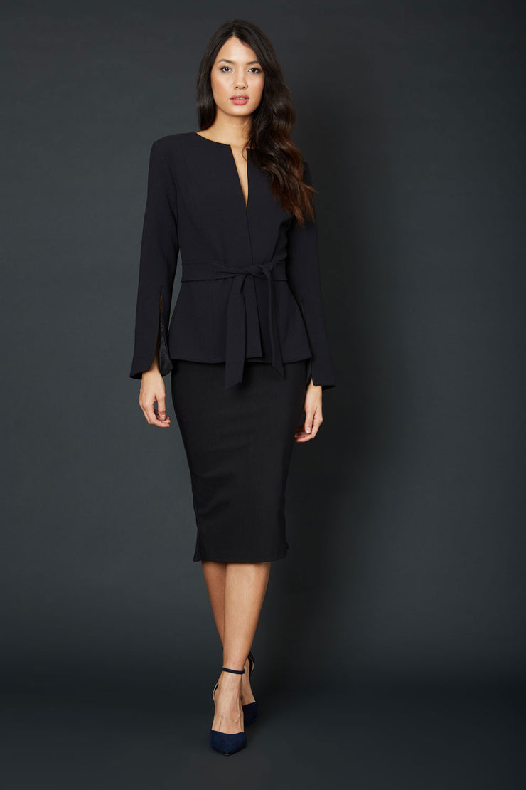 brunette model wearing diva catwalk midi black pencil skirt with black jacket with sleeves front