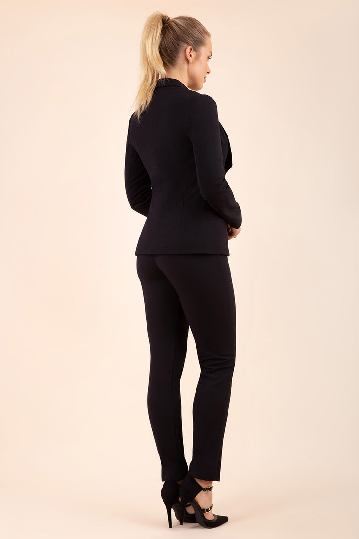 blonde model wearing diva catwalk straight ankle length trousers in black back