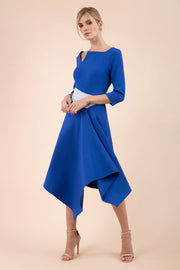 Blonde Model wearing Diva Catwalk Pinto Contrast swing a-line skirt Dress with asymmetric skirt and asymmetric neckline with three quarter sleeve in Cobalt Blue front