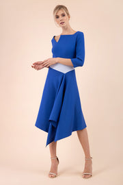 Blonde Model wearing Diva Catwalk Pinto Contrast Swing Dress with asymmetric skirt and asymmetric neckline with three quarter sleeve in Cobalt Blue front