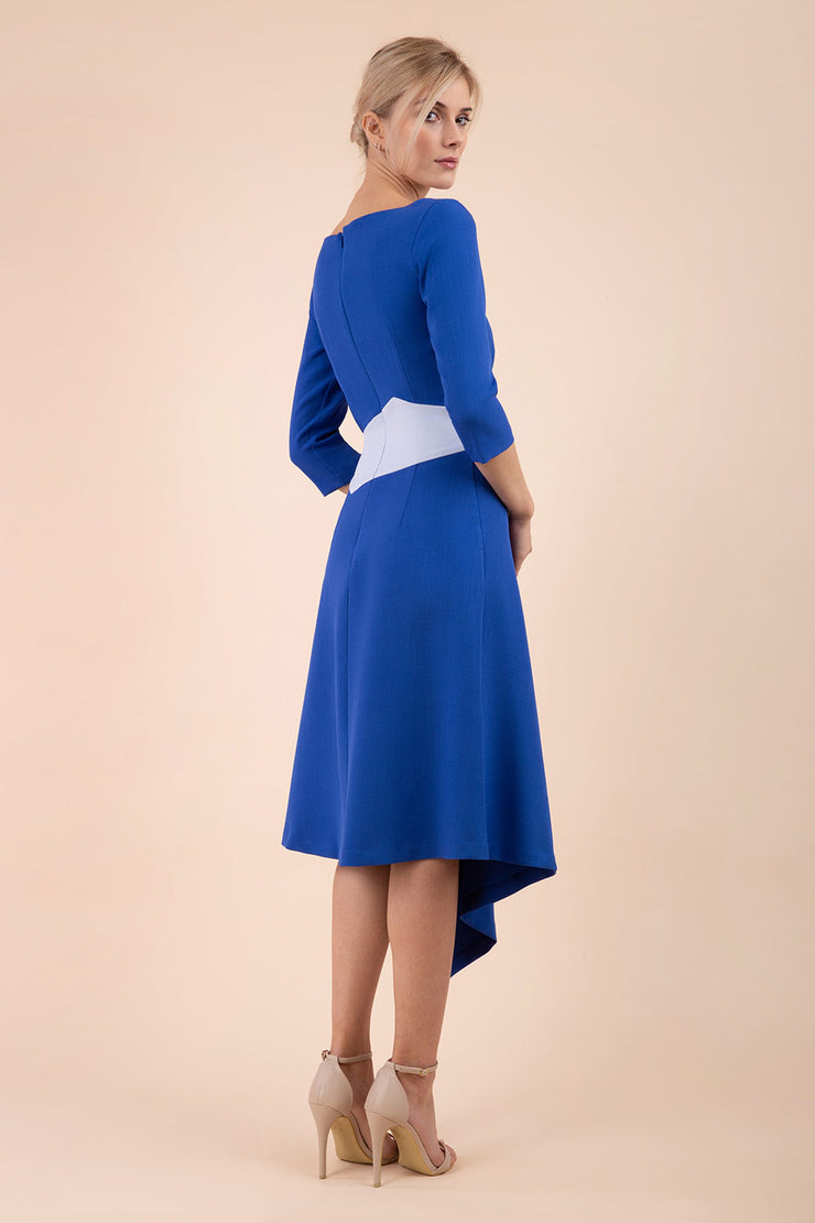 Blonde Model wearing Diva Catwalk Pinto Contrast Swing Dress with asymmetric skirt and asymmetric neckline with three quarter sleeve in Cobalt Blue back