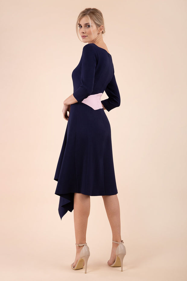 Blonde Model wearing Diva Catwalk Pinto Contrast Swing Dress with asymmetric skirt and asymmetric neckline with three quarter sleeve in Navy Blue back