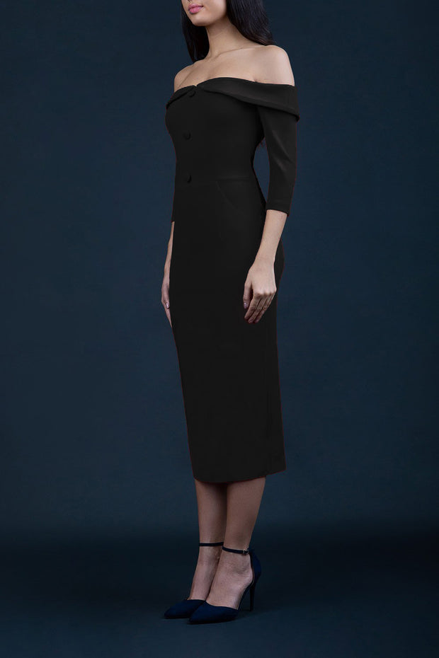 brunette model wearing diva catwalk zorita maxi pencil three quarter fitted dress off-shoulder with bardot neckline and buttons to front with pockets and vent on a skirt in bkack front