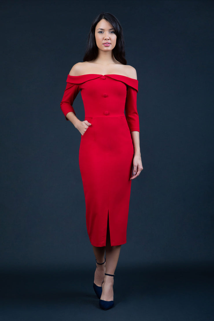 brunette model wearing diva catwalk zorita maxi pencil three quarter fitted dress off-shoulder with bardot neckline and buttons to front with pockets and vent on a skirt in scarlet red front