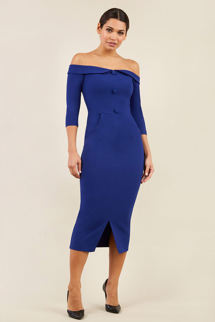 brunette model wearing diva catwalk zorita maxi pencil three quarter fitted dress off-shoulder with bardot neckline and buttons to front with pockets and vent on a skirt in oxford blue front