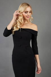 blonde model is wearing three quarter fitted dress off-shoulder with bardot neckline and buttons to front with pockets and vent on a skirt in black front