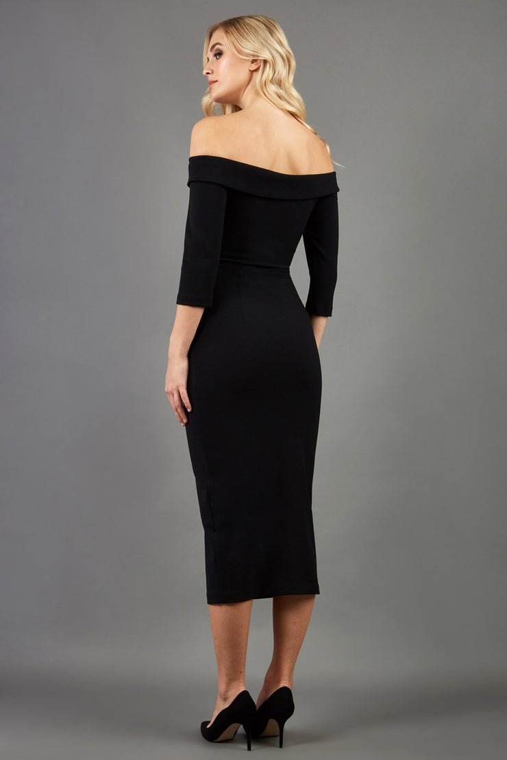 blonde model is wearing three quarter fitted dress off-shoulder with bardot neckline and buttons to front with pockets and vent on a skirt in black back image