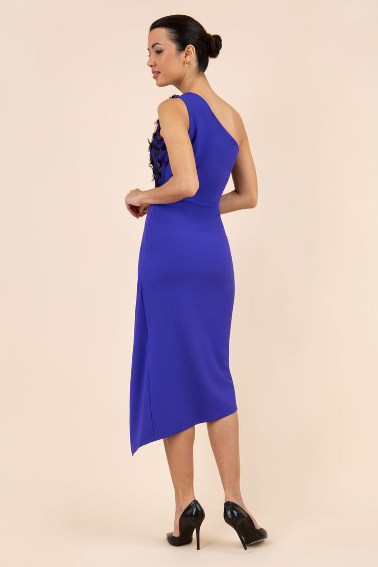 Model wearing the Diva Winslow dress in asymmetric design, one shoulder in spectrum indigo colour back