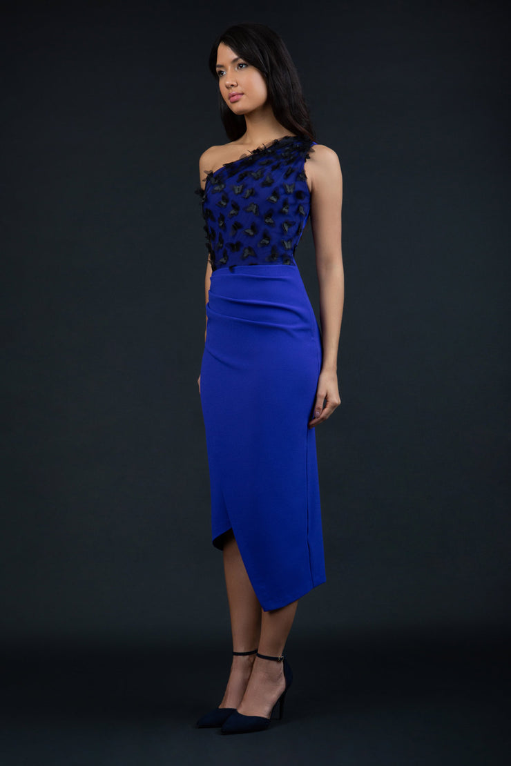 Model wearing the Diva Winslow dress in asymmetric design, one shoulder in spectrum indigo colour front image