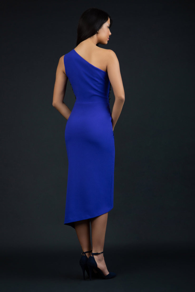 Model wearing the Diva Winslow dress in asymmetric design, one shoulder in spectrum indigo colour back image