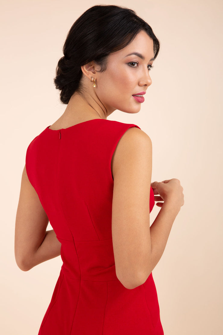 brunette model wearing diva catwalk pencil-skirt red dress with v-neckline and pleating across the tummy without sleeves back