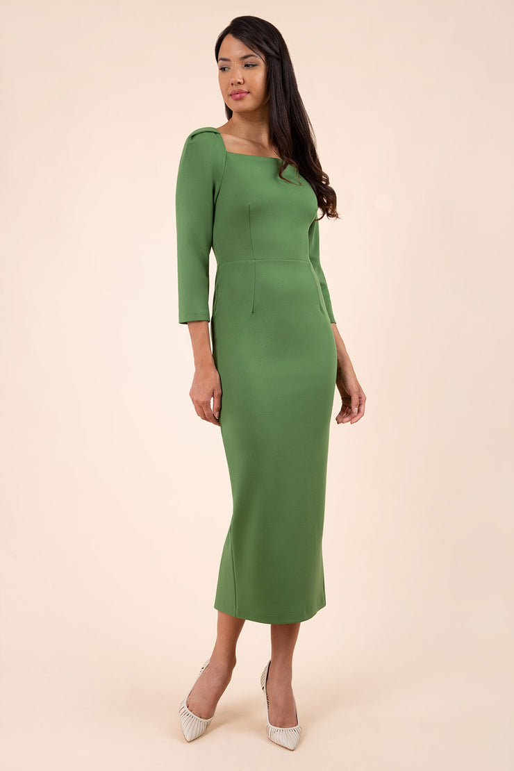 brunette model wearing diva catwalk maxi plain three quarter sleeve dress with pleating on shoulders and square neckline in vineyard green front