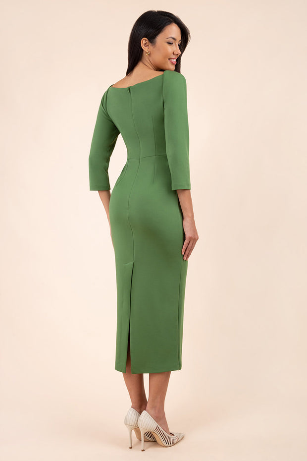 brunette model wearing diva catwalk maxi plain three quarter sleeve dress with pleating on shoulders and square neckline in vineyard green back