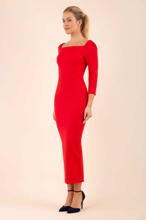 brunette model wearing diva catwalk maxi plain three quarter sleeve dress with pleating on shoulders and square neckline in electric red front