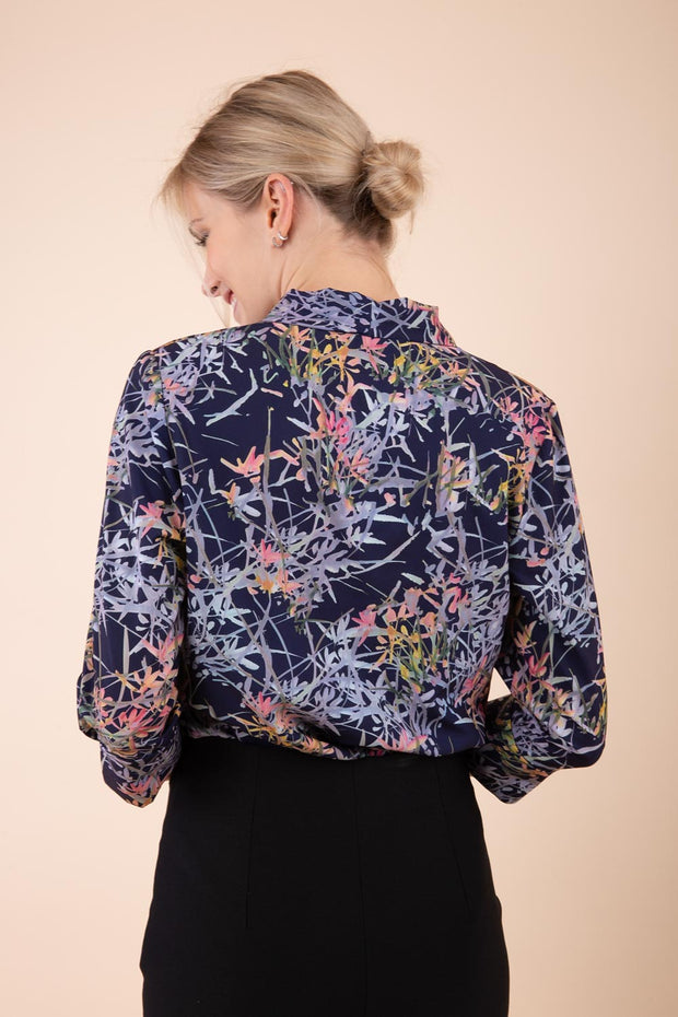 Model wearing the Diva floral top in navy blue back image