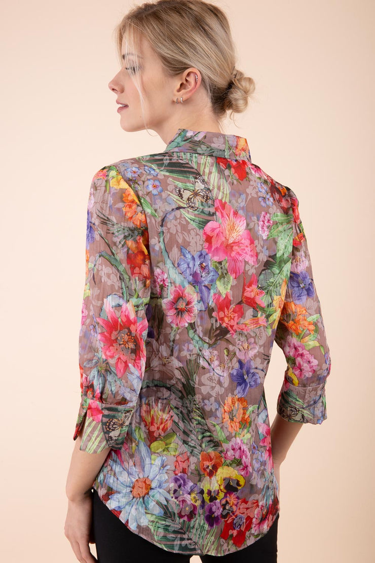 Model is wearing the Diva Branscombe 3/4 Sleeve blouse in floral print taupe back image