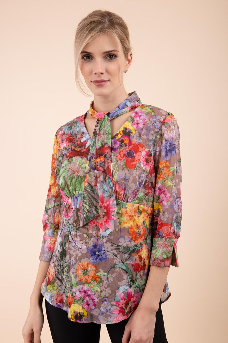 Model is wearing the Diva Branscombe 3/4 Sleeve blouse in floral print taupe front image