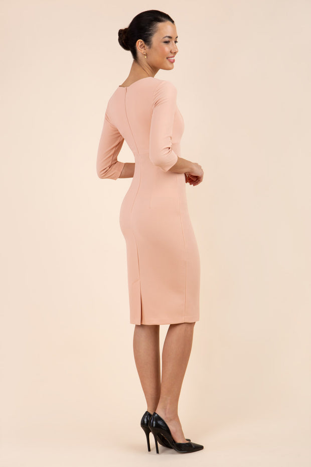 model wearing Diva Catwalk pencil three quarter sleeve dress with a split neckline and pleating across the tummy in almond mousse back