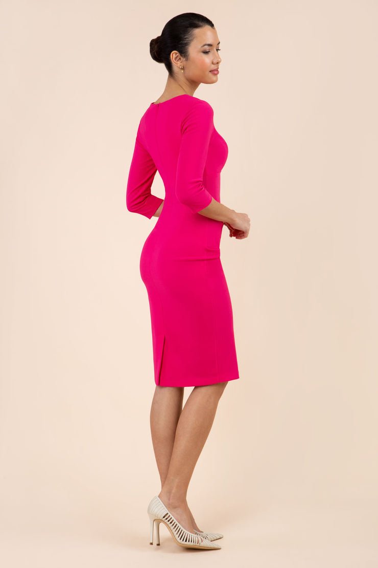 model wearing Diva Catwalk pencil three quarter sleeve dress with a split neckline and pleating across the tummy in pink back