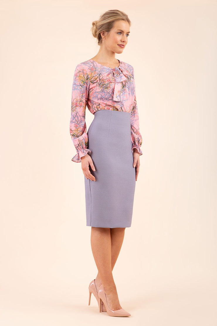 blonde model wearing seed elixir pencil knee length skirt in sky grey front