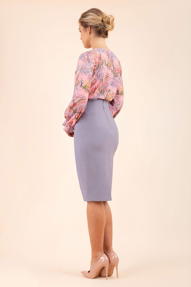 blonde model wearing seed elixir pencil knee length skirt in sky grey back