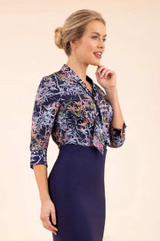 Model wearing the Diva floral top in navy blue front image