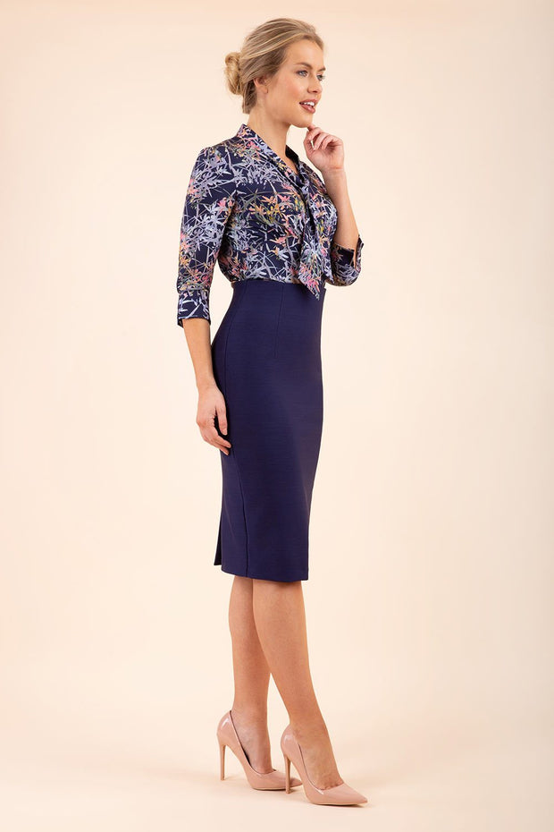 blonde model wearing seed elixir pencil knee length skirt in navy blue front