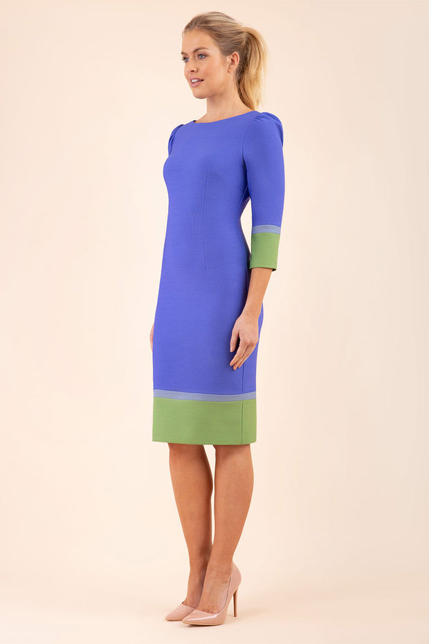 Model wearing the Diva Provence pencil dress design in Thistle blue, citrus green and sky grey colour blocking front image
