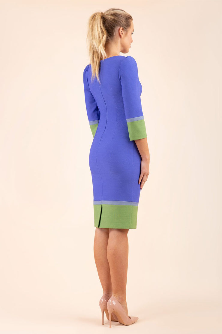 blonde Model wearing seed Provence pencil dress design in Thistle blue, citrus green and sky grey colour blocking back