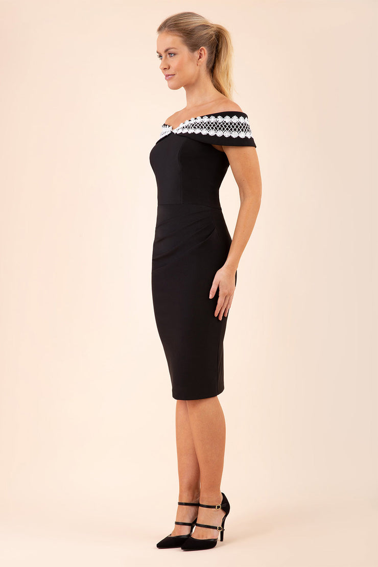 Model wearing the Diva Kurumba pencil dress design in black with white lace trim detailing front image