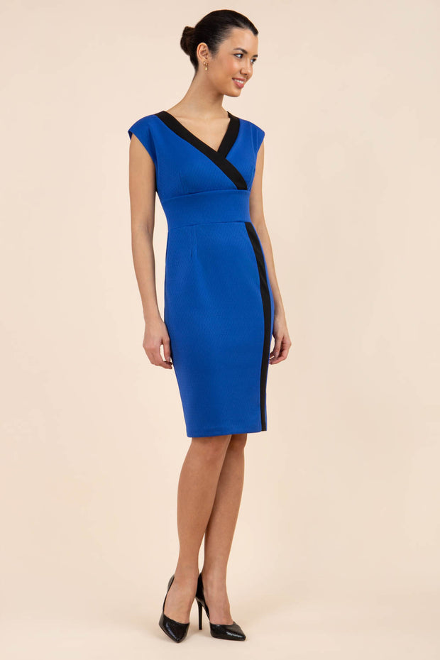 brunette model wearing Diva catwalk Suzy pencil sleeveless dress with v-neckline and wide wasteland in cobalt blue front