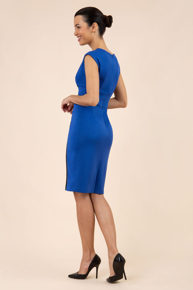 brunette model wearing Diva catwalk Suzy pencil sleeveless dress with v-neckline and wide wasteland in cobalt blue back