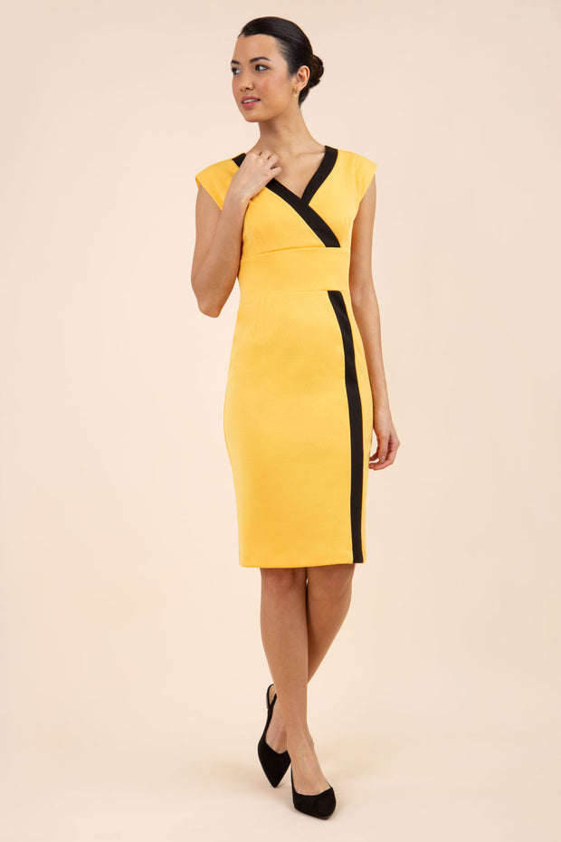brunette model wearing Diva catwalk Suzy pencil sleeveless dress with v-neckline and wide wasteland in radiant yellow front