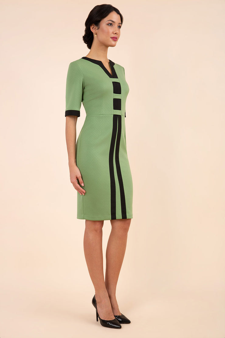 Model wearing the Diva Goggle pencil dress design in green with black, colour block detailing front image